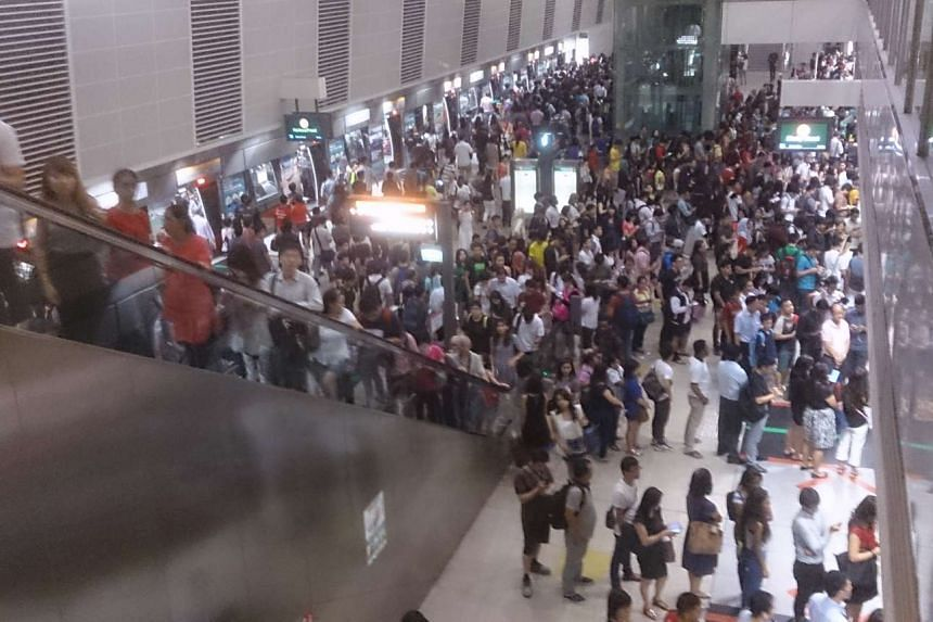 Commuters waiting for their trains at Bishan Station. A train fault along Caldecott station and Farrer Road Station caused wait times to go up to 20 minutes.