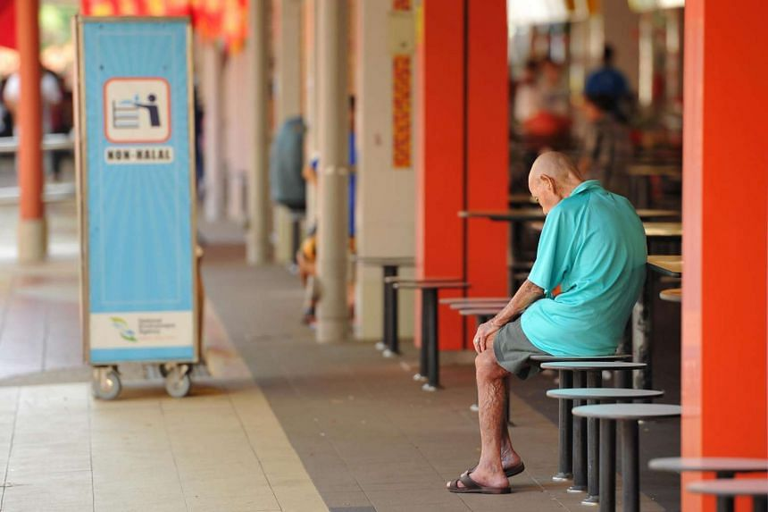 An elderly man sitting at a table in Bukit Merah View Market and Food Centre on April 21.