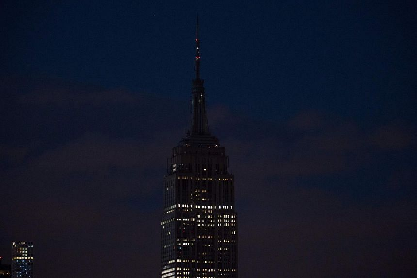 The Empire State Building goes dark in New York on June 12, 2016, in reaction to the mass shooting at a gay nightclub in Orlando, Florida.