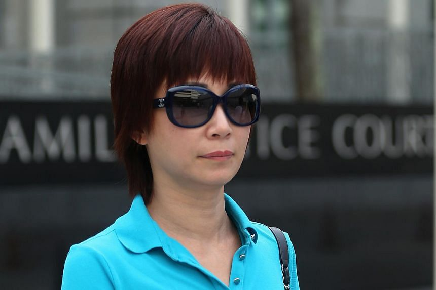 Guan Enmei, former wife of alleged match-fixing kingpin Dan Tan Seet Eng, seen outside State Courts on June 13.
