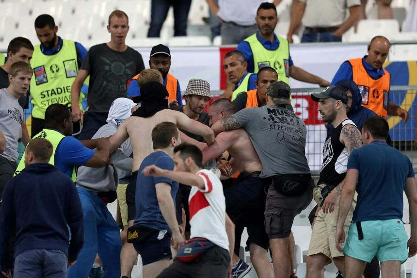 Groups of supporters clash in a fight at the end of the Euro 2016 group B football match between England and Russia at the Stade Velodrome in Marseille on June 11.