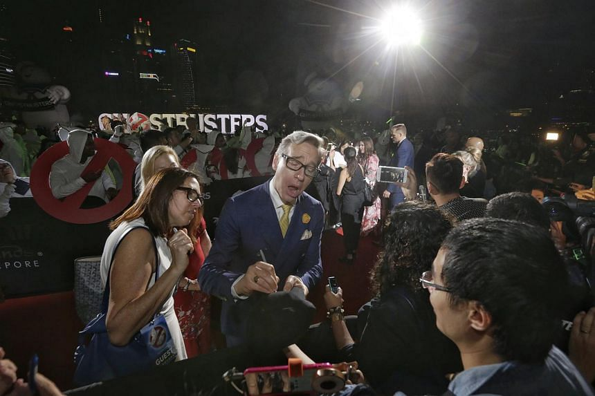 Director Paul Feig (centre) attending the Ghostbusters red carpet at Marina Bay Sands on June 12.