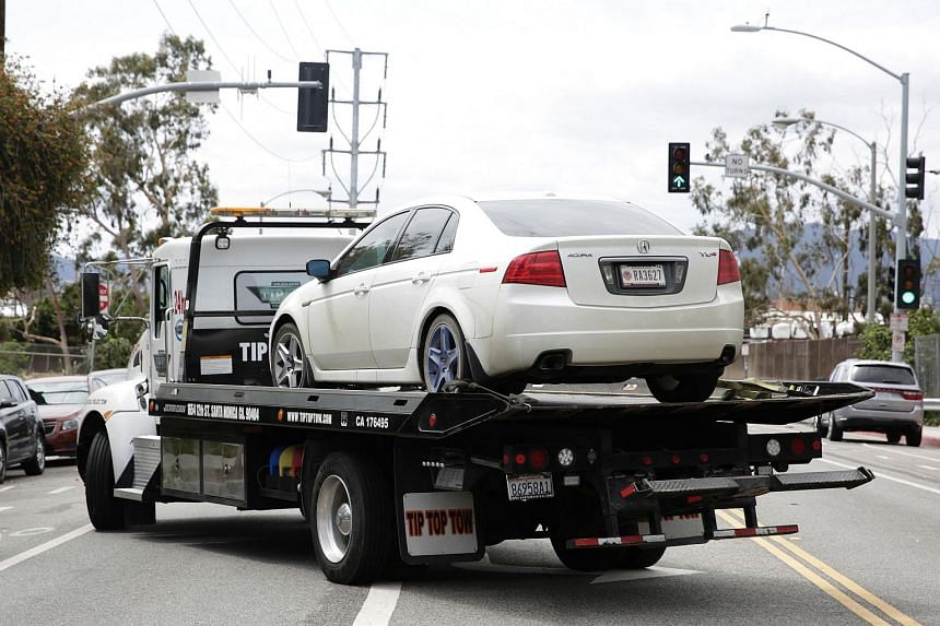 A vehicle reportedly belonging to suspect James Wesley Howell is towed in Santa Monica, California on June 12, 2016.