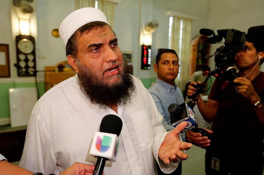 Imam Syed Shafeeq Rahman of the Islamic Centre of Fort Pierce speaks with the media following a prayer for victims of the Orlando shooting.