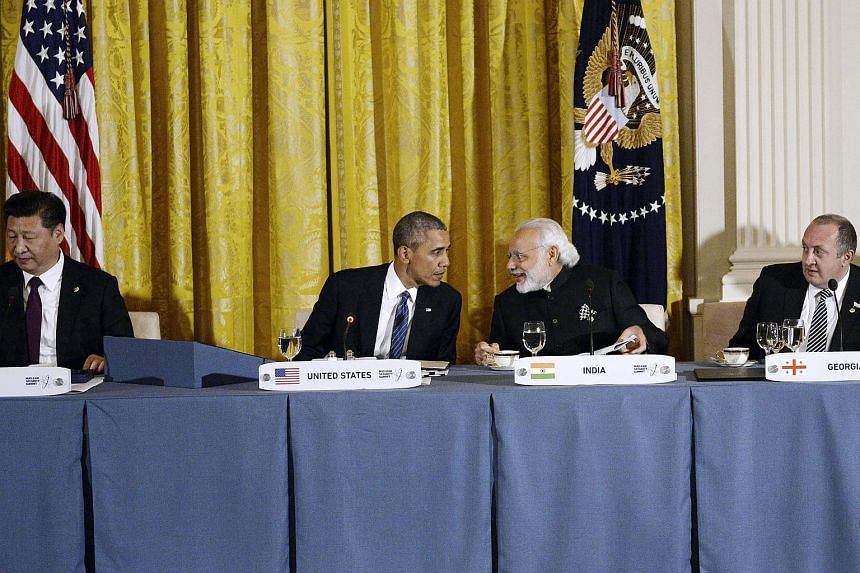 (From left) Chinese President Xi Jinping, US President Barack Obama, India PM Narendrakumar Modi, and President of Georgia Giorgi Margvelashvili attend a working dinner in the East Room of the White House on March 31 in Washington, DC.