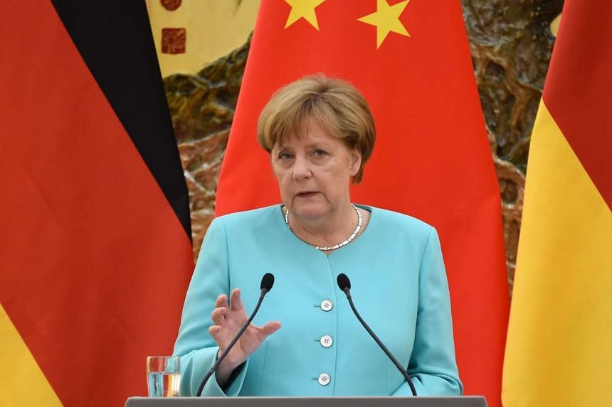 German Chancellor Angela Merkel speaks during a joint press conference with Chinese Premier Li Keqiang at the Great Hall of the People in Beijing on June 13, 2016.