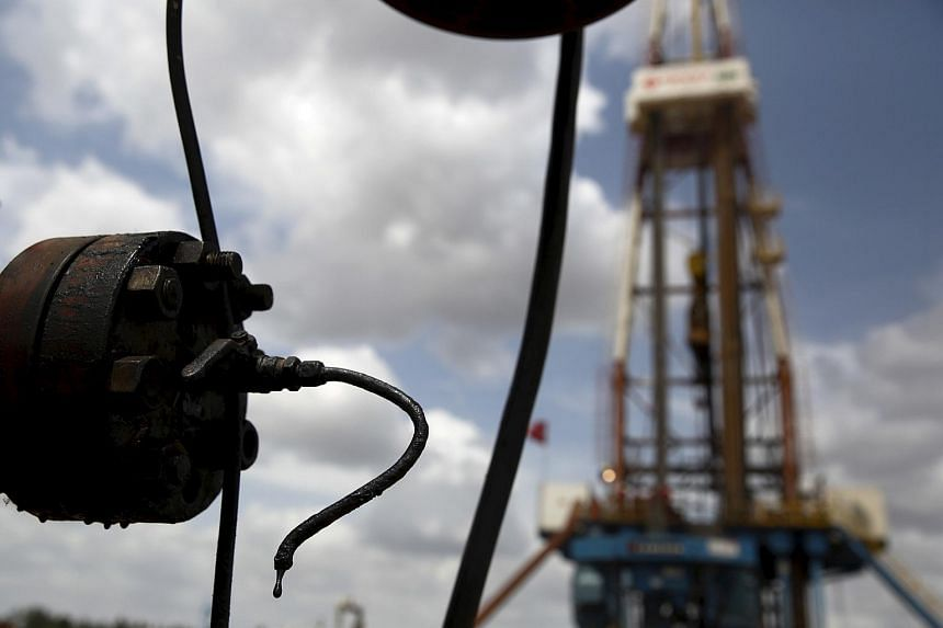 Crude oil drips from a valve at an oil well near Morichal at the state of Monagas on April 16.