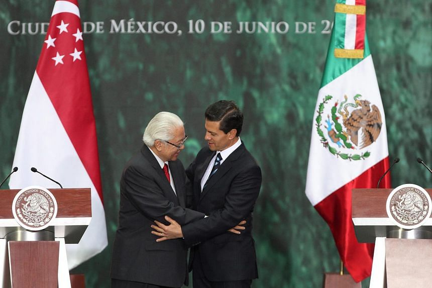 Mexican President Enrique Pena Nieto (right) and Singapore's President Tony Tan Keng Yam participate in a press meeting at the Patio de Honor in the National Palace in Mexico City, Mexico, on June 10.