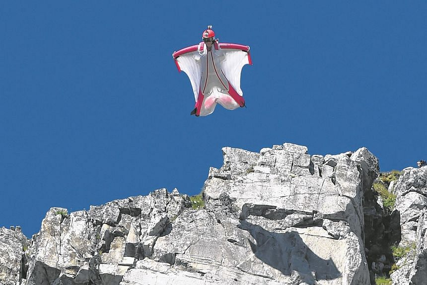 A July 16, 2014 file picture showing Switzerland's Geraldine Fasnacht jumping from the top of the Brevent mountain in a wingsuit.