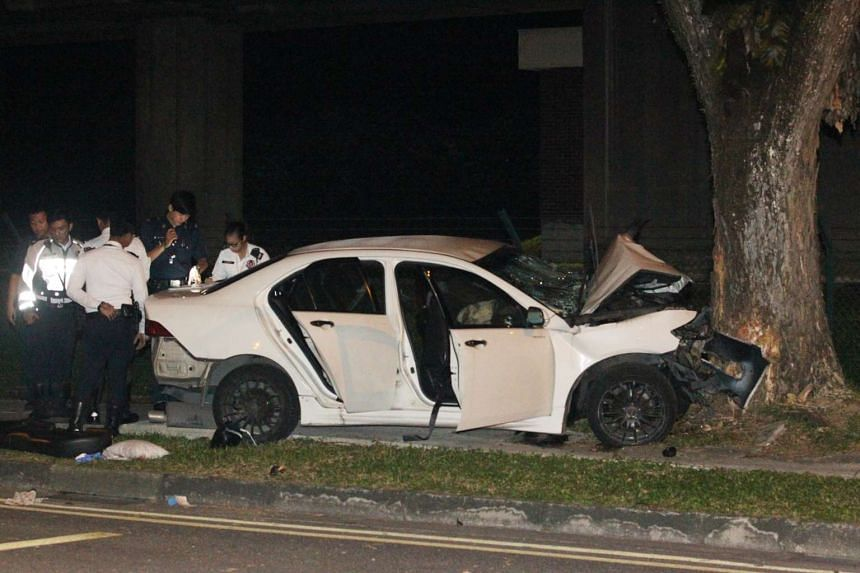 A car carrying a family of four crashed into a tree at about 1.15am at Lentor Avenue on June 14, 2016.