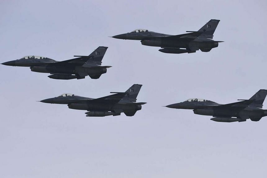 Pakistani F-16 fighter jets fly past during the Pakistan Day military parade in Islamabad, on March 23, 2016.