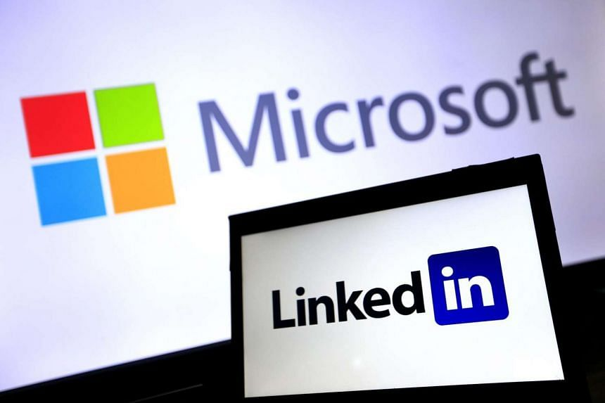The logos of Microsoft and LinkedIn on June 13, 2016.