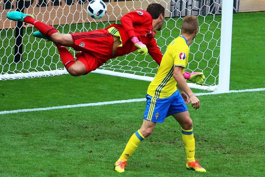 Sweden's goalkeeper Andreas Isaksson (left) receives Ireland's 1-0 lead during the UEFA Euro 2016 Group E preliminary round match between Ireland and Sweden at Stade de France in Saint-Denis, France.