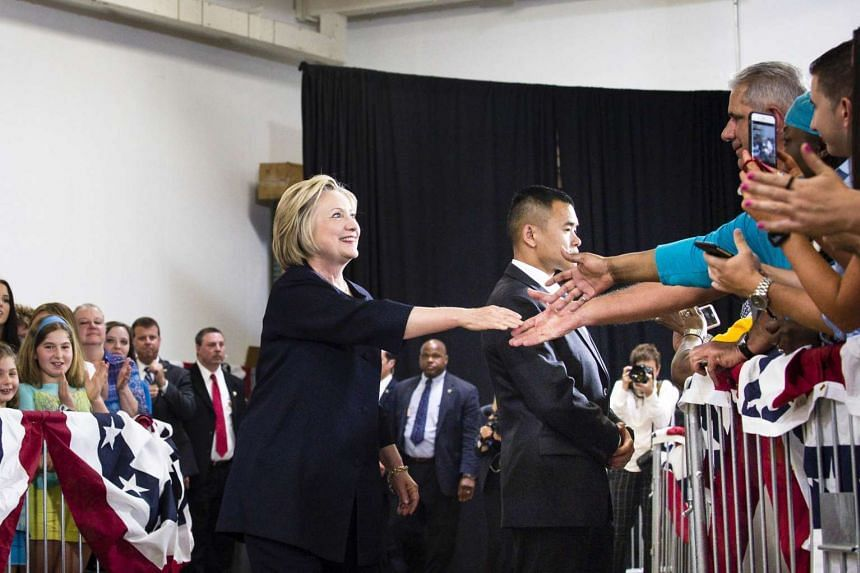 Democratic presidential candidate Hillary Clinton shakes hands with supporters during a campaign stop, on June 13, 2016, in Cleveland, Ohio.