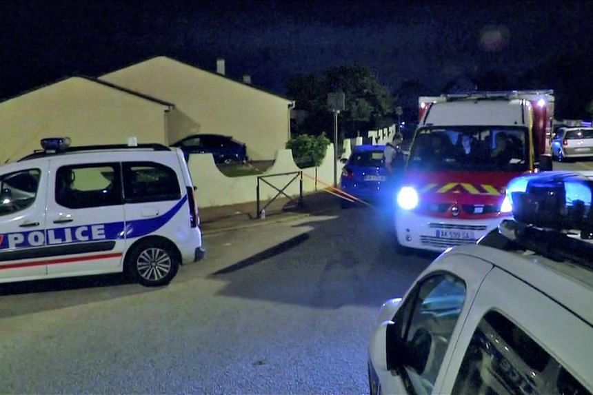Police vehicles at the scene near where a French police commander was stabbed to death in front of his home in the Paris suburb of Magnanville, France, on June 14, 2016.