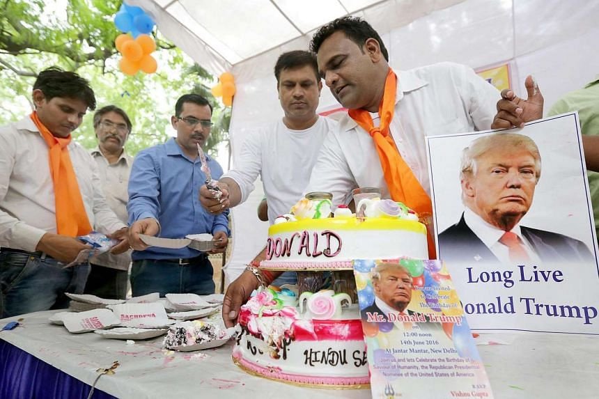 Indian activists from the Hindu right-wing organisation Hindu Sena celebrate the 70th birthday of Donald Trump, in New Delhi, on June 14, 2016.