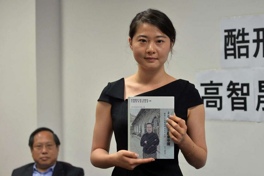 Grace Geng, daughter of Gao Zhisheng, a renowned human rights lawyer in China, holds her father's book A Human Rights Lawyer under Torture – the auto narratives of Gao Zhisheng, in Hong Kong, on June 14, 2016.