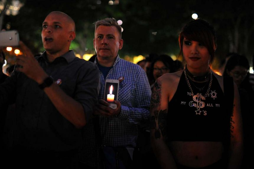 People join the LGBT community at Hong Lim park in a vigil for the victims of the Orlando shooting in Florida, on June 14, 2016.