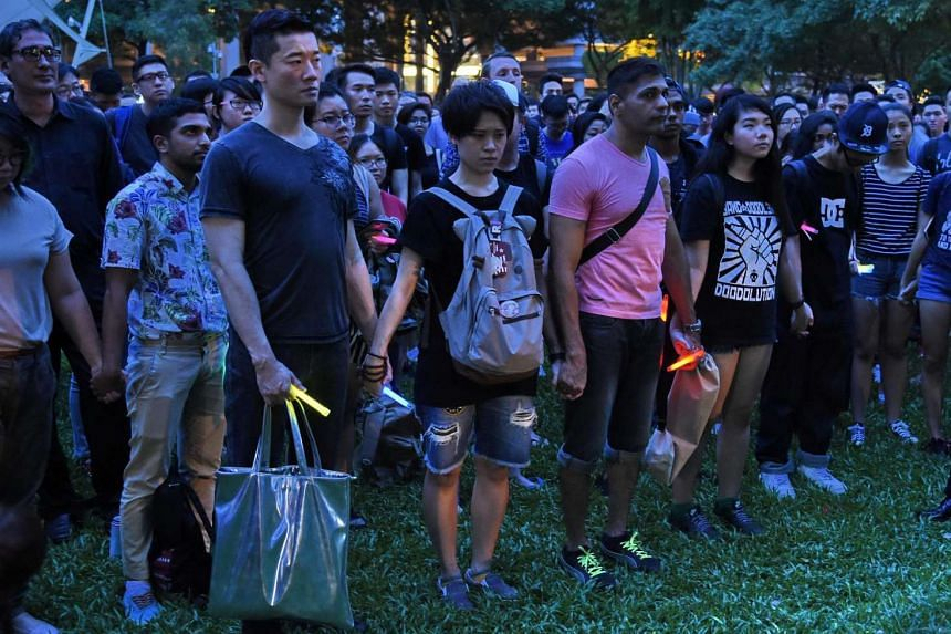 People join the LGBT community as they hold hands at Hong Lim park in a vigil for the victims of the Orlando shooting in Florida, on June 14, 2016.