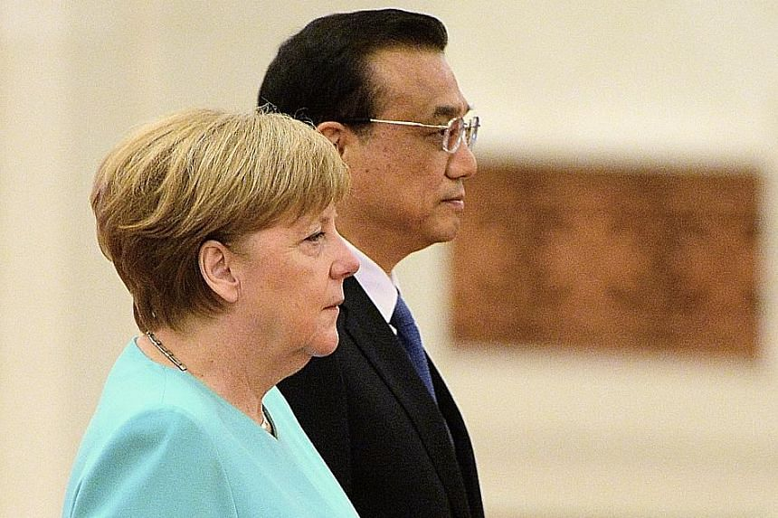 Dr Merkel and Mr Li met at the Great Hall of the People yesterday.