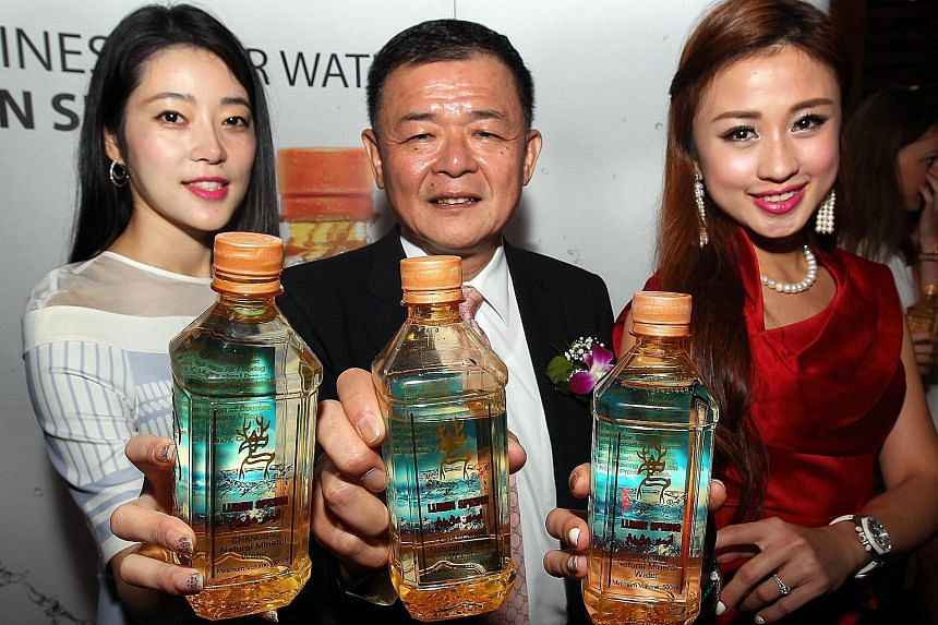 """Lumin Spring director Philip Ting showing off his company's bottled mineral water that comes with the Jakim halal logo. He says: """"If we tell buyers that our water is Malaysian halal-certified, it sells better."""" New halal items on the market now inclu"""