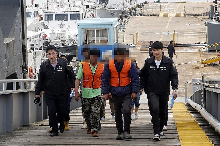 Chinese fishermen being escorted to a police station in Incheon, South Korea, on Sunday.