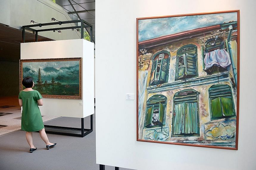 Foreground: Raymond Lau Poo Seng's oil on canvas titled Window No. 2. Background: Koeh Sia Yong's oil on canvas titled Bali Lake.