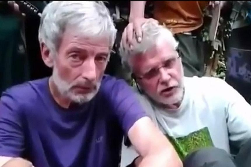 Mr Hall (left) is said to have been beheaded by the Abu Sayyaf. His compatriot, Mr Ridsdel (at right), was beheaded in April.