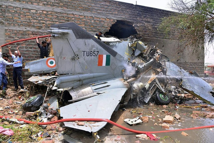 An Indian Air Force MiG-27 fighter jet crashed near the western state of Rajasthan's Jodhpur city yesterday, a senior defence official said. Though two pilots ejected safely, three people on the ground were injured and a building near the crash site