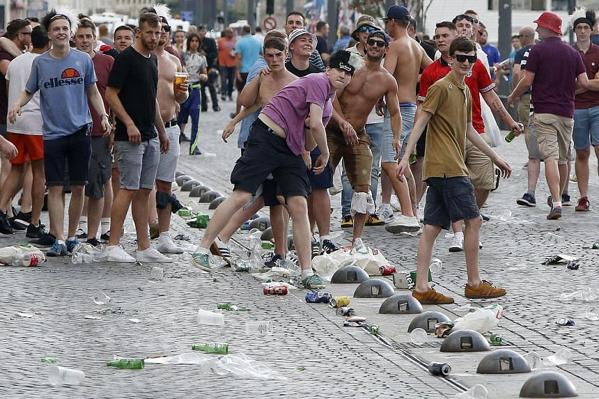 Fans throwing objects at riot police during clashes between English and Russian supporters at Marseille's Vieux Port last Friday, the eve of their teams' first-round match. The unrest last Saturday, which left more than 30 people injured, prompted Ue