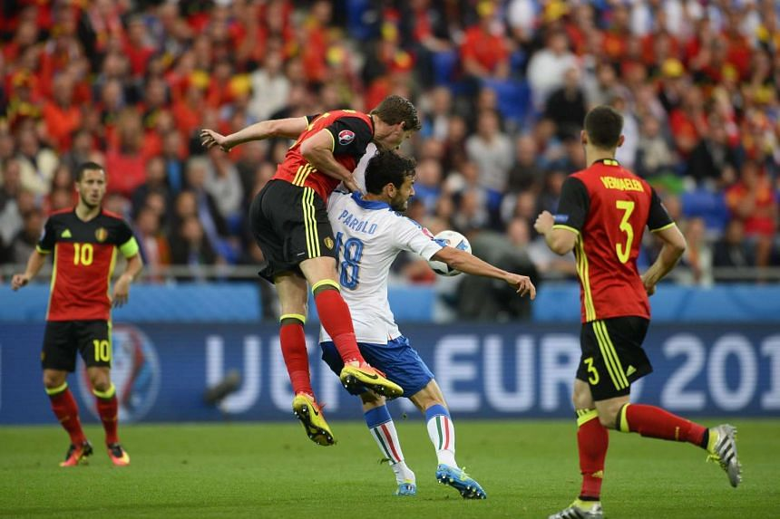 Marco Parolo of Italy (second from right) in action against Jan Vertonghen (second from left) of Belgium during the UEFA Euro 2016 Group E preliminary round match between Belgium and Italy at Stade de Lyon in Lyon, France.