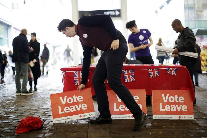 """Vote Leave"" campaigners set out their stall in Manchester, UK on June 11."