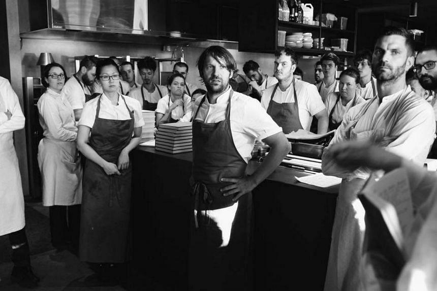A staff meeting at Noma Australia. René Redzepi (center) is a two-star chef originally from Copenhagen, Denmark.
