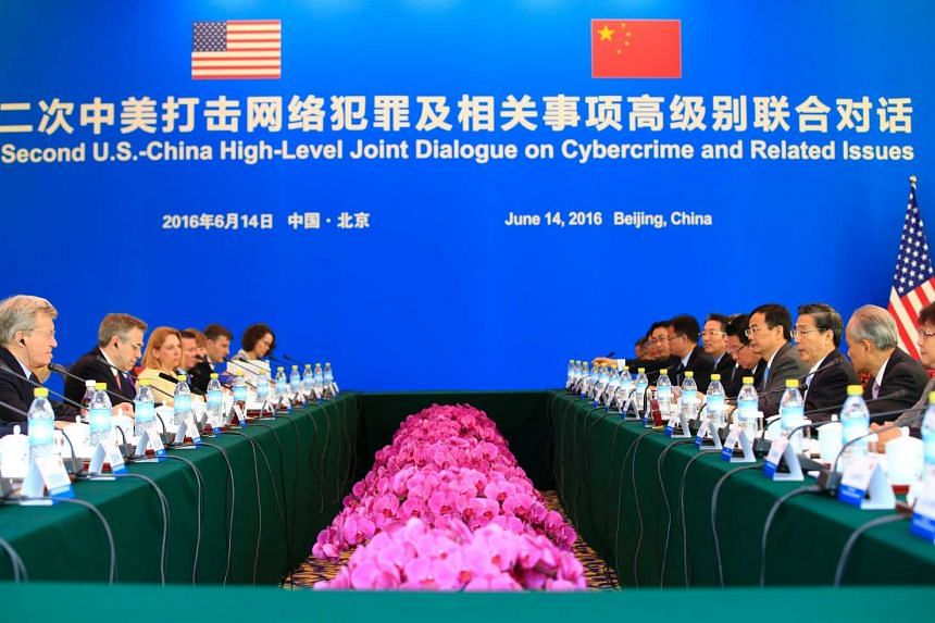 China's Minister of Public Security Guo Shengkun (third from right) and US Ambassador to China Max Baucus (second from left) at the second US-China High-Level Joint Dialogue on Cybercrime and Related Issues in Beijing, on June 14, 2016.