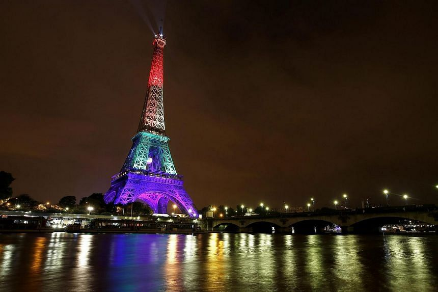 The Eiffel Tower is illuminated in rainbow colours in honour of the victims.