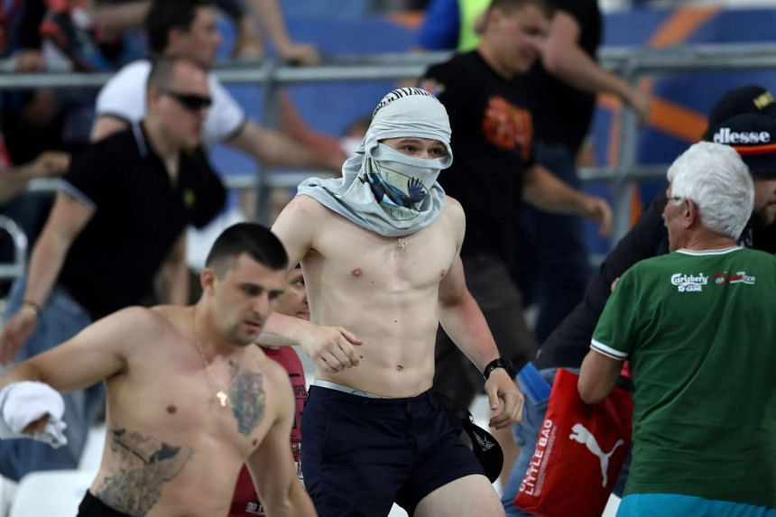 People leave the stadium following clashes between Russian and English supporters on June 11, 2016.