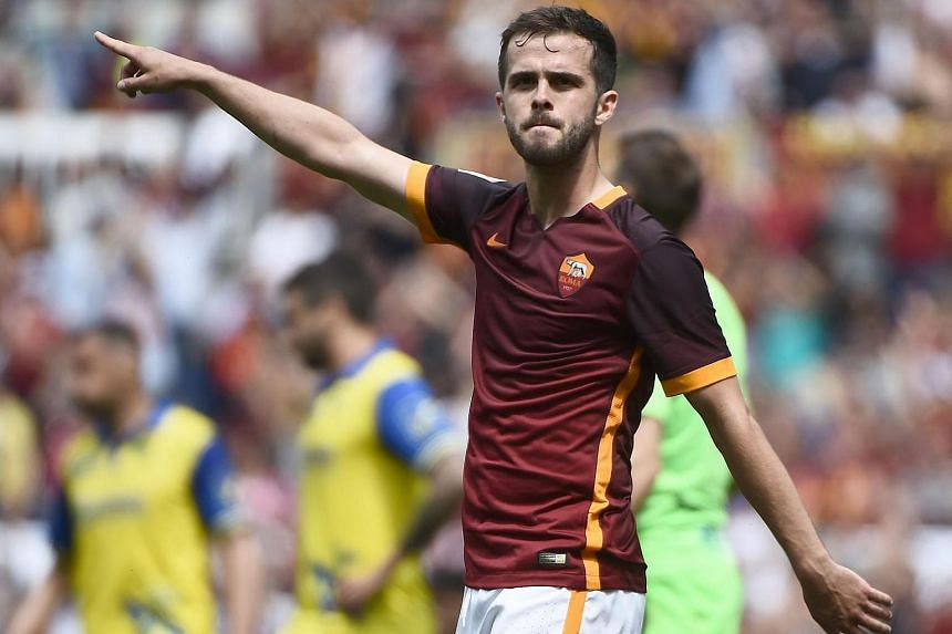 Miralem Pjanic celebrates after scoring during the Italian Serie A football match between Roma and Chievo.