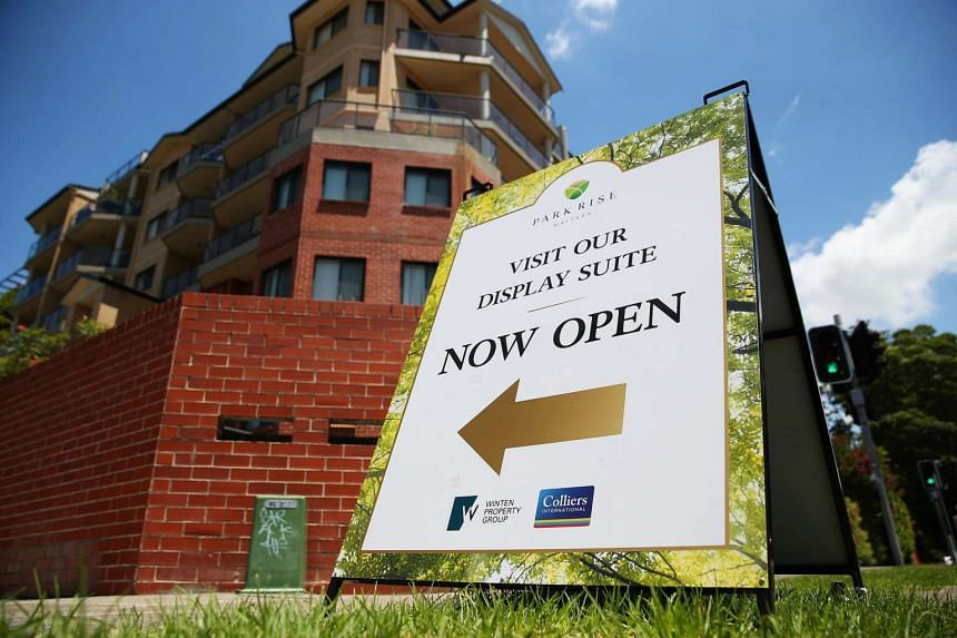 A sign pointing to the display suite of Winten Property Group's Park Rise residential development stands on a street corner in the suburb of Waitara, Sydney.