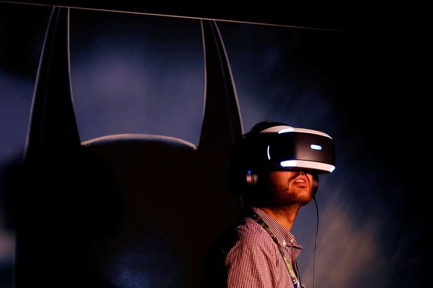 A man tries the new Sony VR headset during Sony Corporation's PlayStation 4 E3 2016 event in Los Angeles, on June 13, 2016.