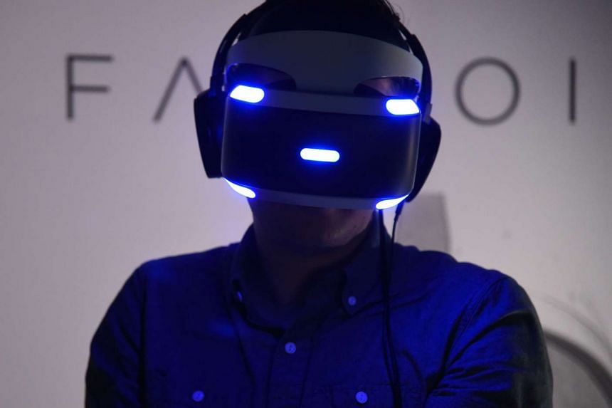A man tries the new Sony VR headset at the Sony PlayStation E3 event at the Shrine Auditorium in Los Angeles, on June 13, 2016.