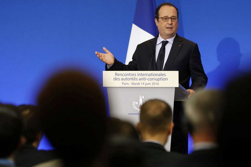 French President Francois Hollande gestures as he speaks at the opening of the International Anti-Corruption Practitioner Conference in Paris, on June 14, 2016.
