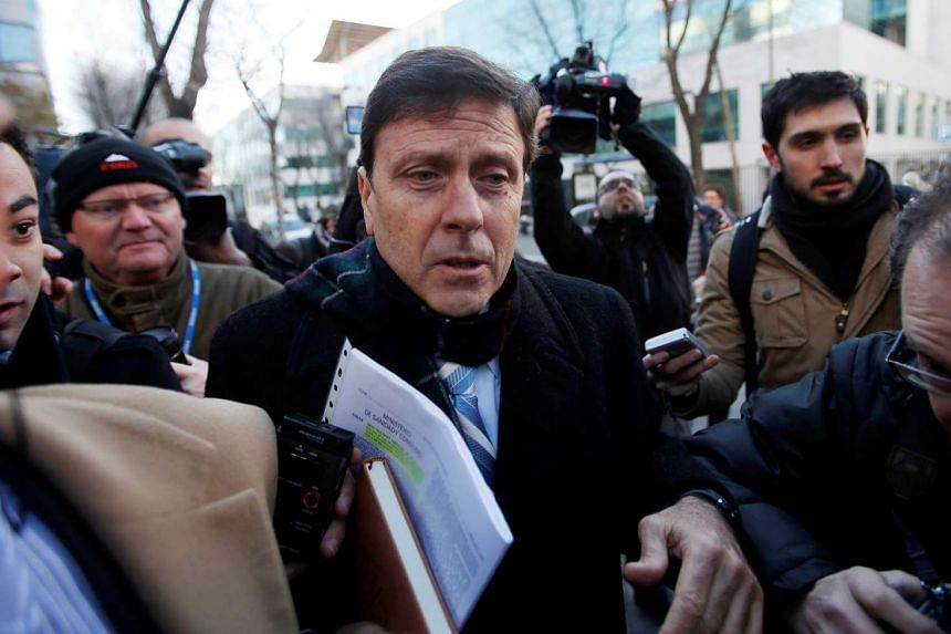 Spanish doctor Eufemiano Fuentes is surrounded by media as he enters a courthouse on the first day of the Operation Puerto doping trial in Madrid, on Jan 28, 2013.