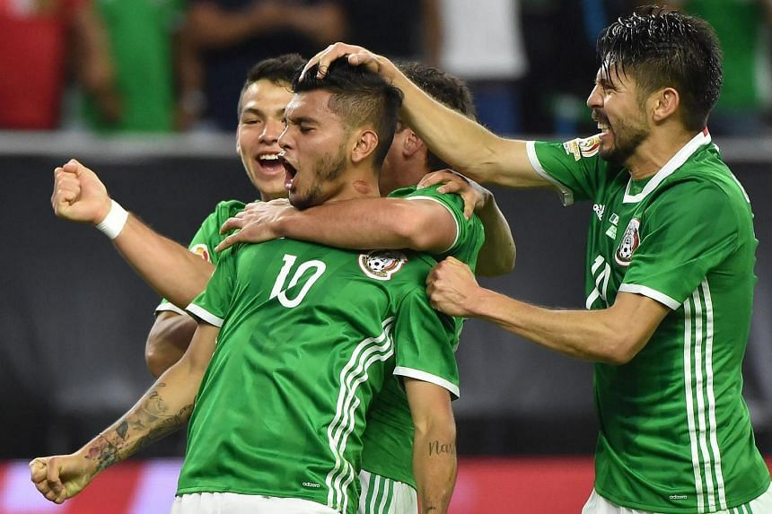 Mexico's Jesus Manuel Corona (centre) celebrates with teammates after scoring against Venezuela during their Copa America football match.
