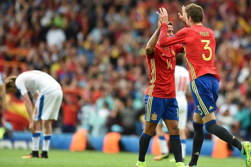 Gerard Pique (right) celebrates with Thiago Alcantara after scoring the opening goal during the Euro 2016 group D football match between Spain and Czech Republic.