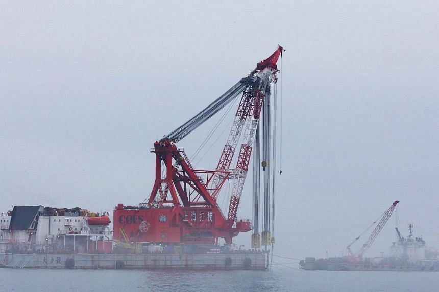 A giant crane that will lift up the sunken Sewol ferry is seen during a salvage project in the sea off Jindo on June 12, 2016.