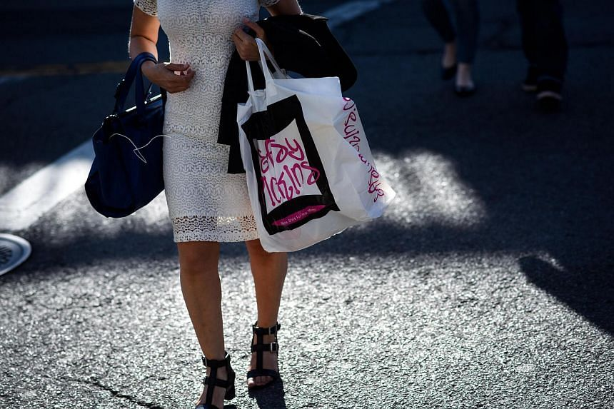 A shopper walking along Steinway Street in the Queens borough of New York, US, on June 9.