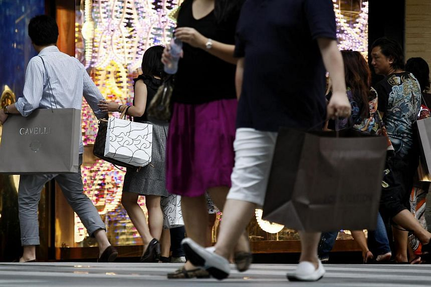 People carrying shopping bags seen walking down Orchard Road.