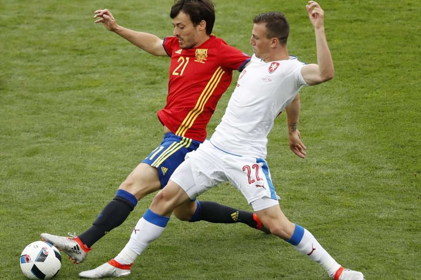 Czech Republic's Vladimir Darida (right) in action with Spain's David Silva at the Group D game on Monday in Stadium de Toulouse.