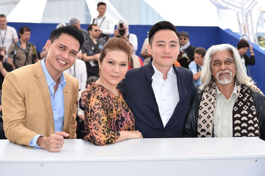 Apprentice is written and directed by Boo Junfeng (above, third from left, seen in Cannes with cast members Fir Rahman, Mastura Ahmad and Wan Hanafi Su).