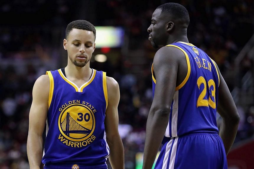 Stephen Curry #30 of the Golden State Warriors and Draymond Green #23 react during the second half against the Cleveland Cavaliers in Game 3 of the 2016 NBA Finals.